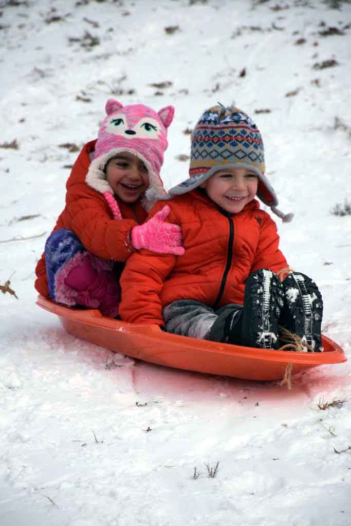 A pair of young girls enjoy the ride in Bronx Park at Lydig Avenue in the Allerton section. Photo by Edwin Soto