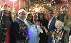 (left to right): Senator Jeff Klein, Assemblyman Luis Sepulveda, and District Leader Julia Rodriguez are joined by the Holy Family Choir and nativity performers as they celebrate Three Kings Day.