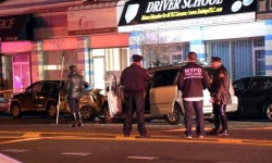 Police investigate the crash that killed one man and injured five others outside a Boston Road driving school. Photo by Edwin Soto