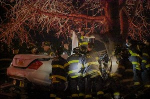 Firefighter's frantically attempt to reach to victims who perished on the Bronx River Parkway last Friday morning. Photo by Edwin Soto