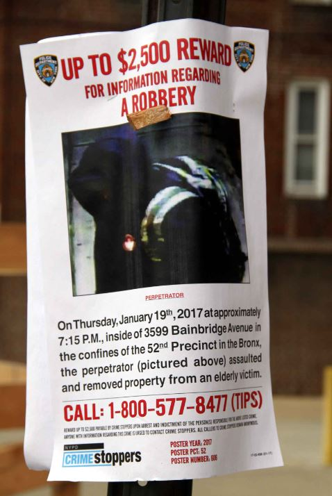 An NYPD wanted poster seeks the individual who assaulted and robbed an elderly victim inside of 3599 Bainbridge Avenue. Photo by David Greene