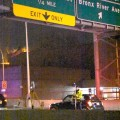 Police investigate after a man was struck by two vehicles as he crossed the Bruckner Expressway.--Photo by Edwin Soto
