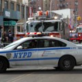 Police and fire department vehicles shutdown Jerome Avenue after a partial collapse of a 2-story public parking garage on Jerome Avenue.--Photo by David Greene