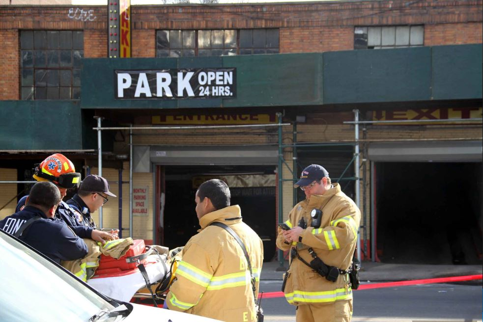 Paramedics waiting for the all clear after a partial building collapse was reported at Dr. Parking, located at 3000 Jerome Avenue in Bedford Park.--Photo by David Greene