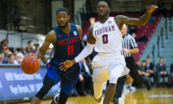 Bronx native, Scoochie Smith attempts to drive past Fordham's Antoine Anderson, during A-10 match at Fordham University in the Bronx, on Tuesday evening January 31, 2017. (Robert Cole)