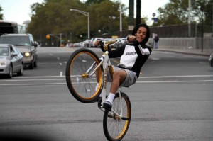 A young man recently showed off his skills at the intersection of Jerome Avenue and Bedford Park Boulevard. Photo by David Greene