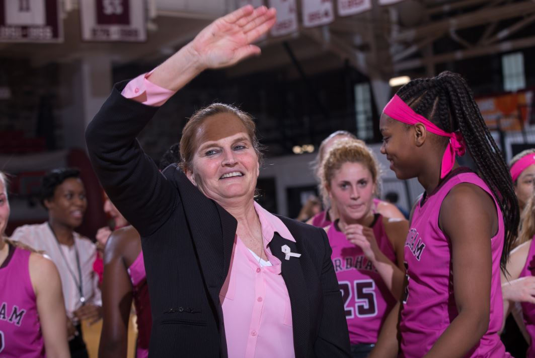 Coach Stephanie Gaitley acknowledges the support of her fans after setting school wins record against UMass. Photo credit: Robert Cole