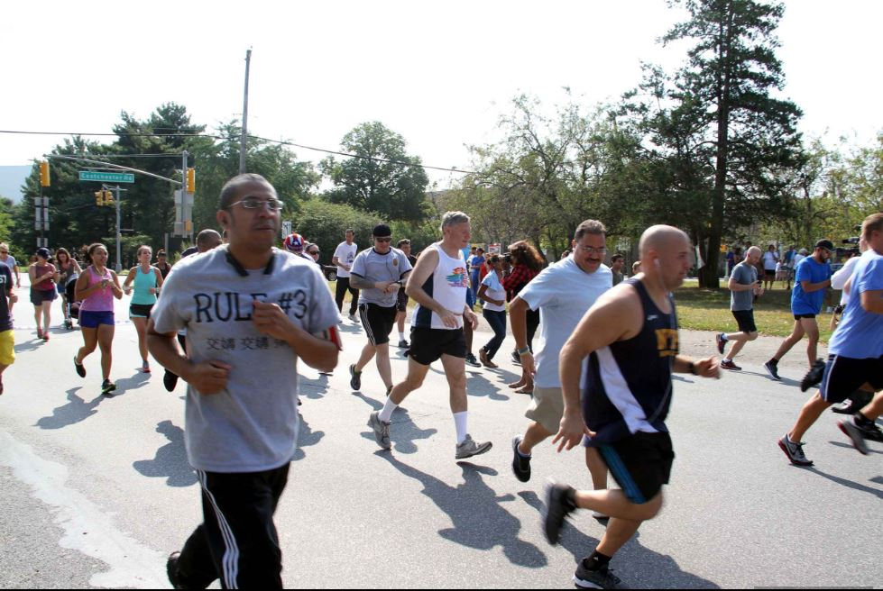 Dozens of participants jogged or walked along Pelham Parkway during the annual event. Photo by David Greene