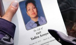 A mourner holds memorial service program for fallen EMT member Yadira Arroyo. Photo by David Greene