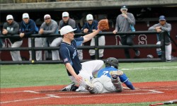 Lehman's Steve Cuello beats throw home to score during the Lehman verse John Jay game on Saturday afternoon at Fordham University in the Bronx. Credit: Robert Cole
