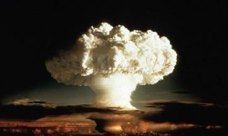 The mushroom cloud of the first test of a hydrogen bomb is seen in a 1952 test blast.