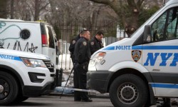 Cops guard the scene as detectives investigate the death of a woman outside of Woodlawn Cemetery on Jerome Avenue. Photo by David Greene