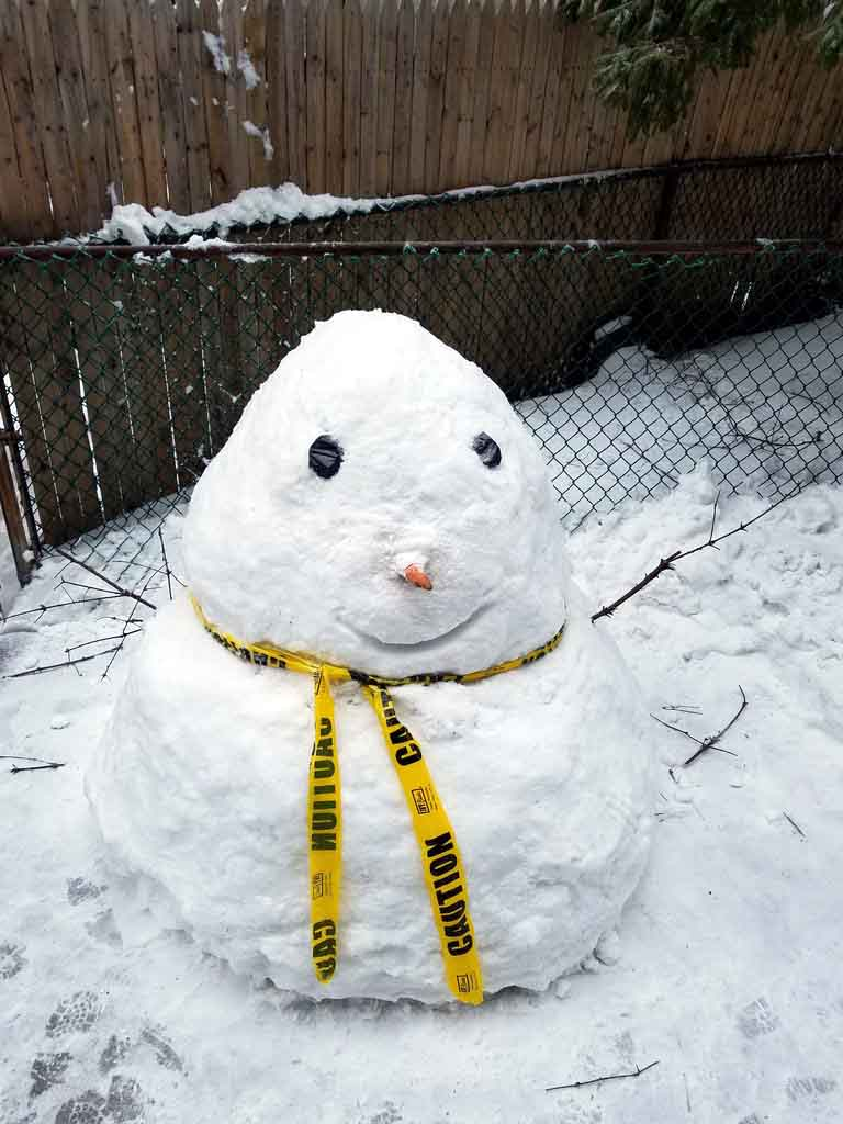 With a day off from school, children in Pelham Bay spent time building a snowman.--Photo by Edwin Soto