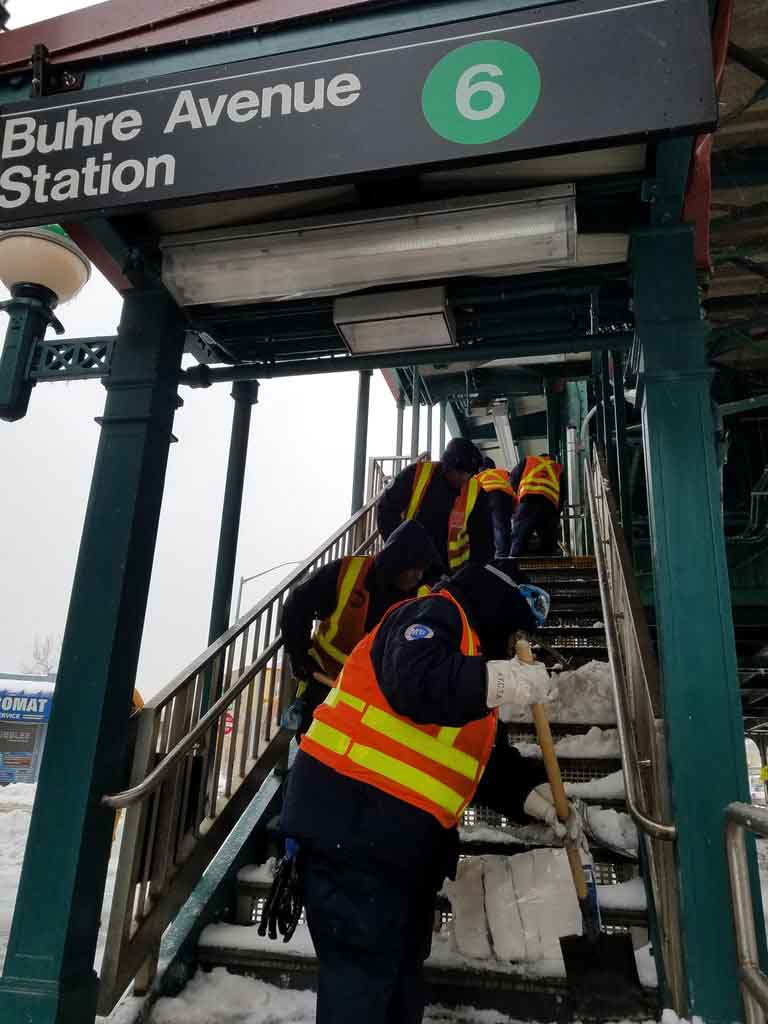 Transit worker's clean the stairs to the closed elevated subway train in Pelham Bay.--Photo by Edwin Soto