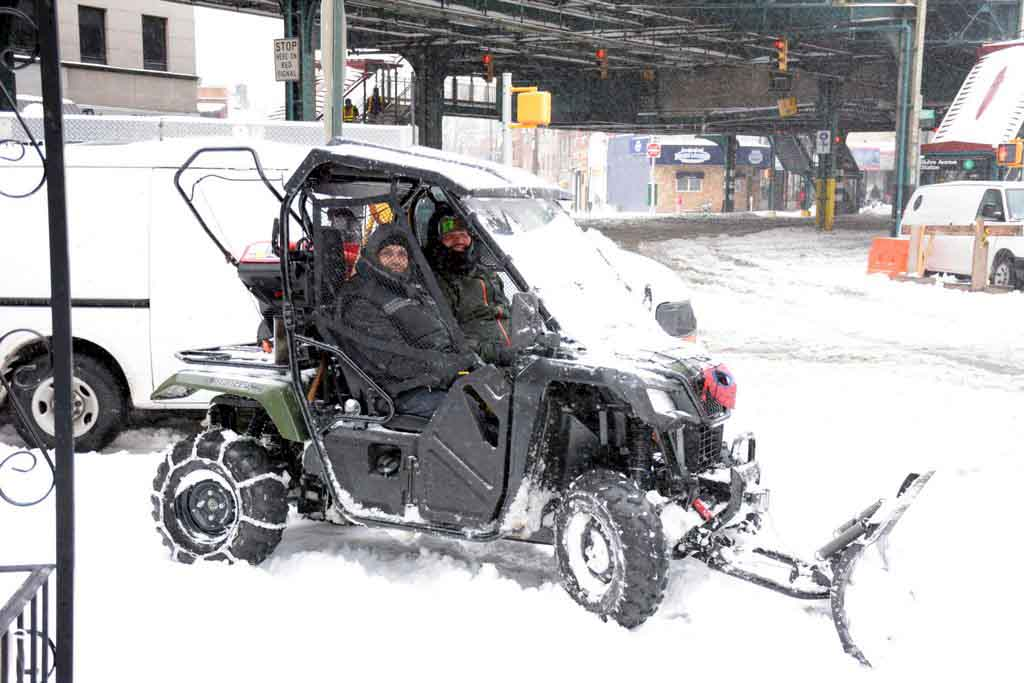 on Edison Ave & Westchester Ave. Eli Rodriguez & Edward Rosado of Jovian Mangement Apartments plowing sidewalk