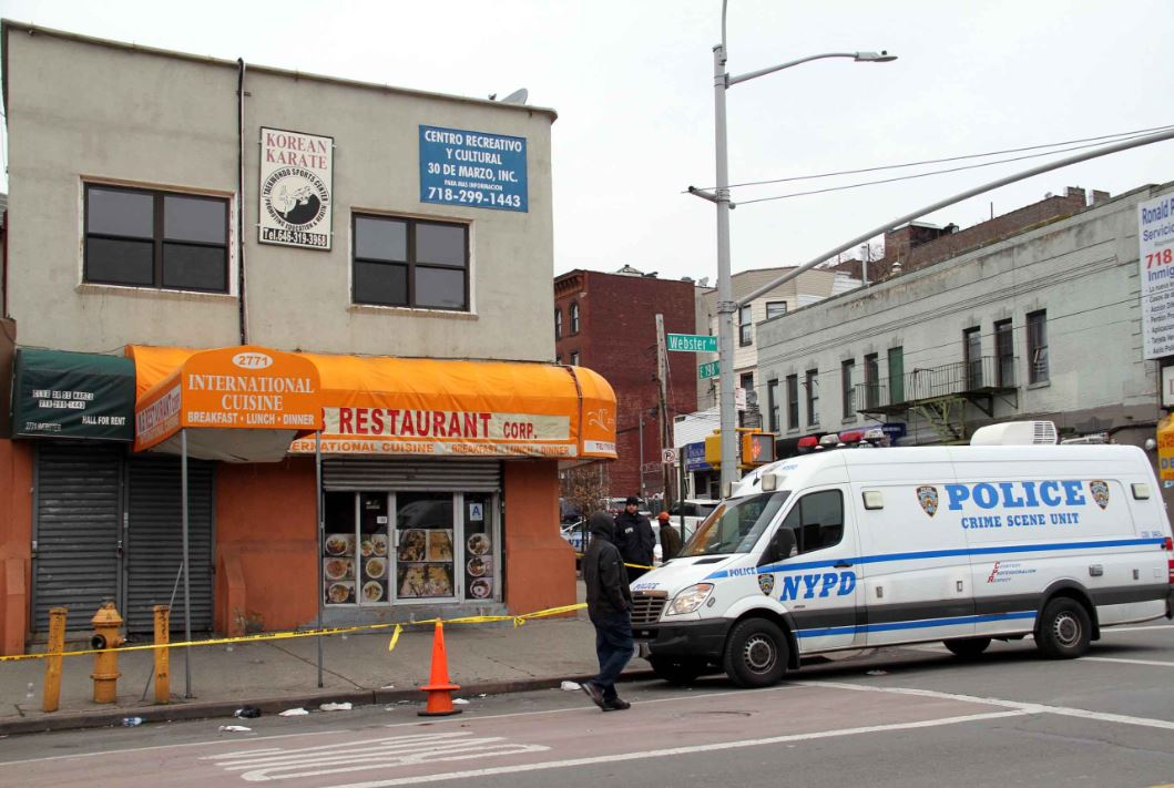 Police say the two men were shot as they were parked in front of the M.B. Restaurant at Webster Avenue and East 198 Street on Sunday morning. Photo by David Greene