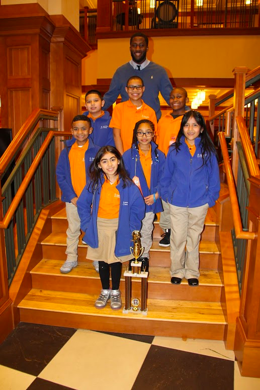 SA Bronx 3 Scholars and Coach Dakim Vanderpool with their trophy! Photo credit Tom Perna.