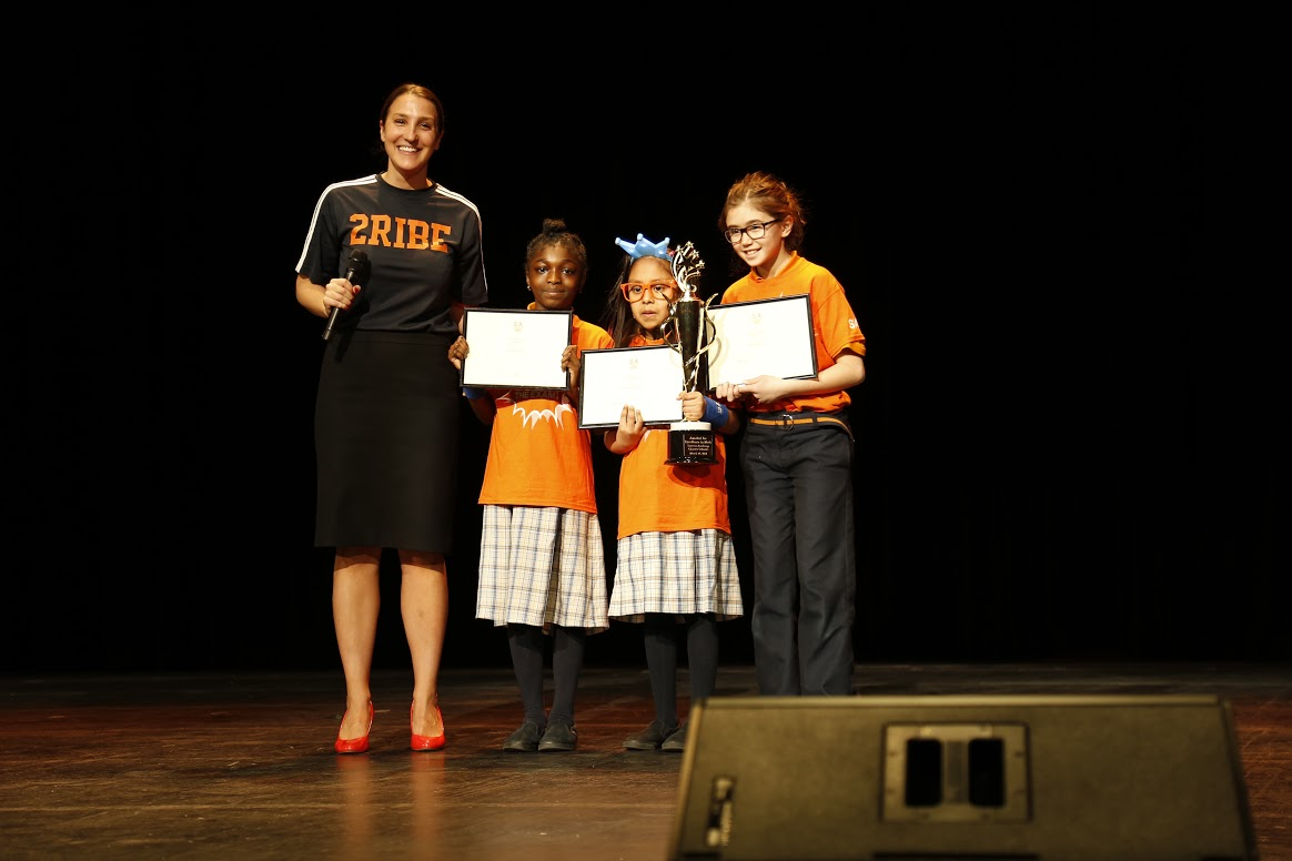 Ms. Mackall, Principal of Success Academy Harlem 2, presents the Math Excellence Award to three scholars: Gloria Aka, Fourth Grader at SA Harlem 3 Upper, Marlen Vargas, Fourth Grader at Harlem 1, and Olivia Naporano, Fourth Grader at SA Upper West. For the first time in SA history, all three of these scholars tied for first place, achieving the highest level on Math assessments