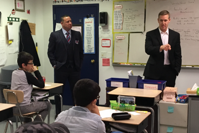 Assemblymember Andrew Hevesi (right) takes questions on the homeless crisis from students at the Association for Metroarea Autistic Children during a visit to the school with Brad Gerstman (left), founder of the Disability Rights Project