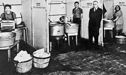 "The first laundromat, called a ""Washateria,"" was opened today by John F. Cantrell in Fort Worth, Texas. (Credit: Retro Newser)"