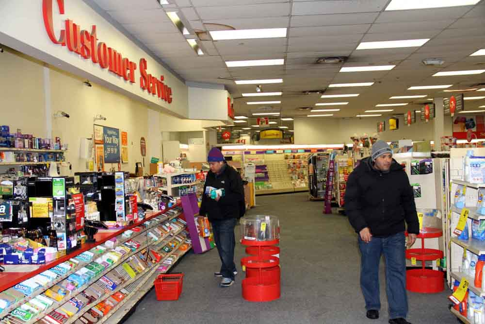Customers shop for the last time at the CVS on East Gun Hill Road in Norwood.--Photo by David Greene