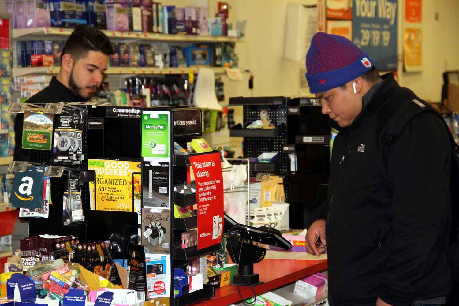 A customer makes his last purchase at the CVS store at 310 East Gun Hill Road.--Photo by David Greene