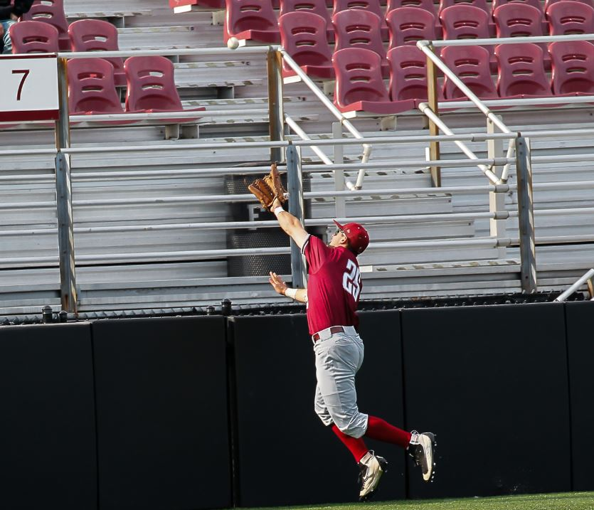 St. Joseph's Cal Jadacki, cannot reach game winning homer during A-10 baseball game between St. Joseph and Fordham at Houlihan Park, in the Bronx, New York on April 13, 2017. (Credit: Robert Cole).