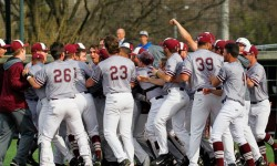 Fordham players mob Jason Lundy, celebrating his game-winning homer to win A-10 baseball game between St. Joseph and Fordham at Houlihan Park, in the Bronx, New York on April 13, 2017. (Credit Robert Cole).