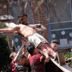 Roman soldiers nail Jesus to the cross marking Good Friday.--Photo by David Greene