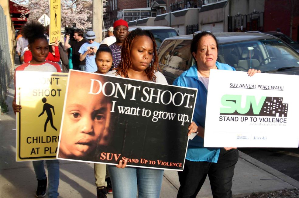 Community members march against violence after a 26 year-old woman was shot dead on East 214 Street in Williamsbridge. Photo by David Greene