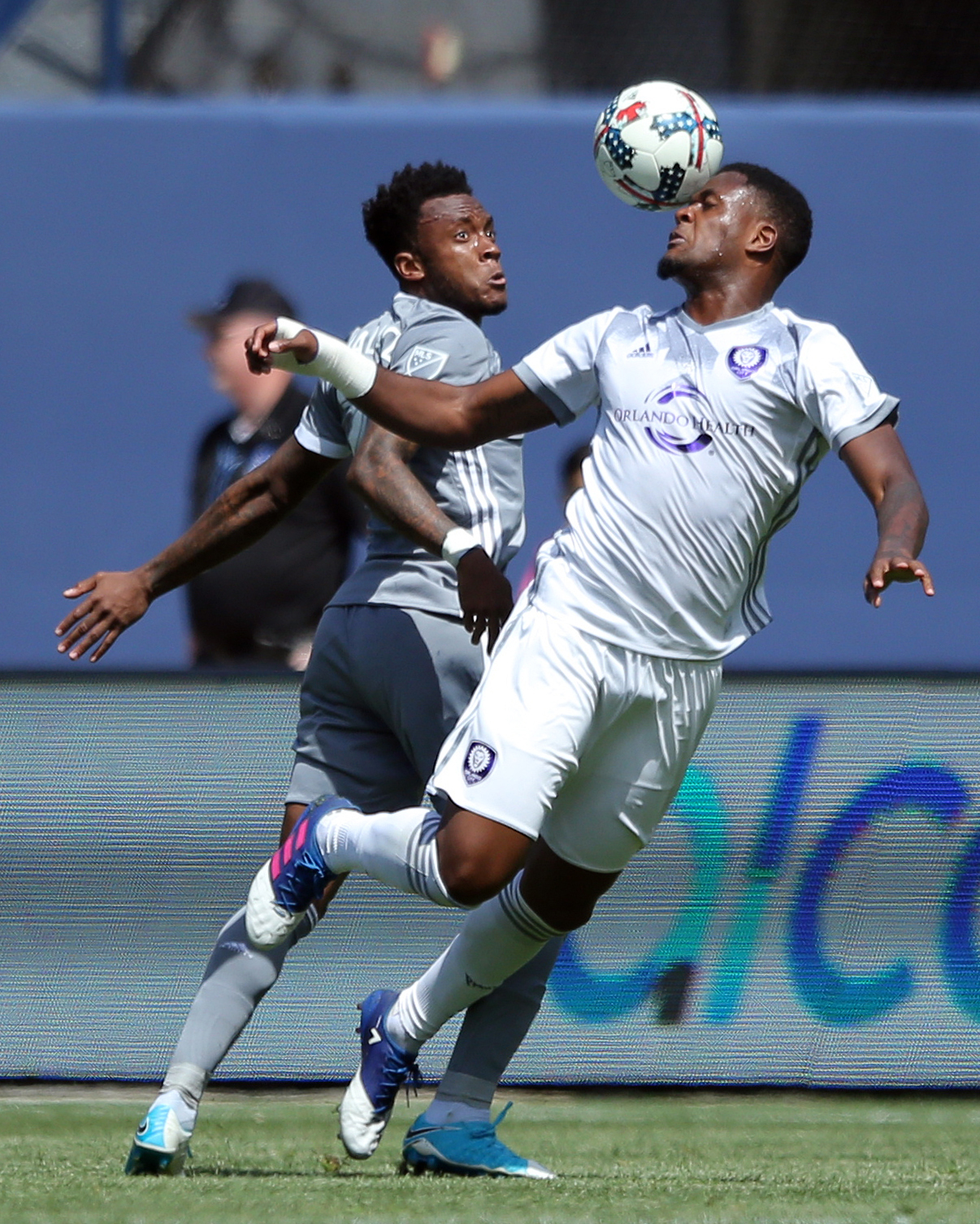 Apr 23, 2017; New York, NY, USA; Orlando City SC forward Cyle Larin (9) plays the ball against New York City FC midfielder Rodney Wallace (23) during the first half at Yankee Stadium. Mandatory Credit: Brad Penner-USA TODAY Sports