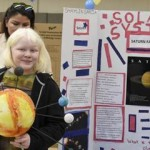 Solar System Visually impaired 6th grader Shaylin Garcia proudly showcases her solar system exhibit at the New York Institute for Special Education's 15th annual science fair on April 5. More than 200 pre-school to high school students with visual impairments, emotional challenges and developmental delays participated in the event. (Credit: James Rivera)