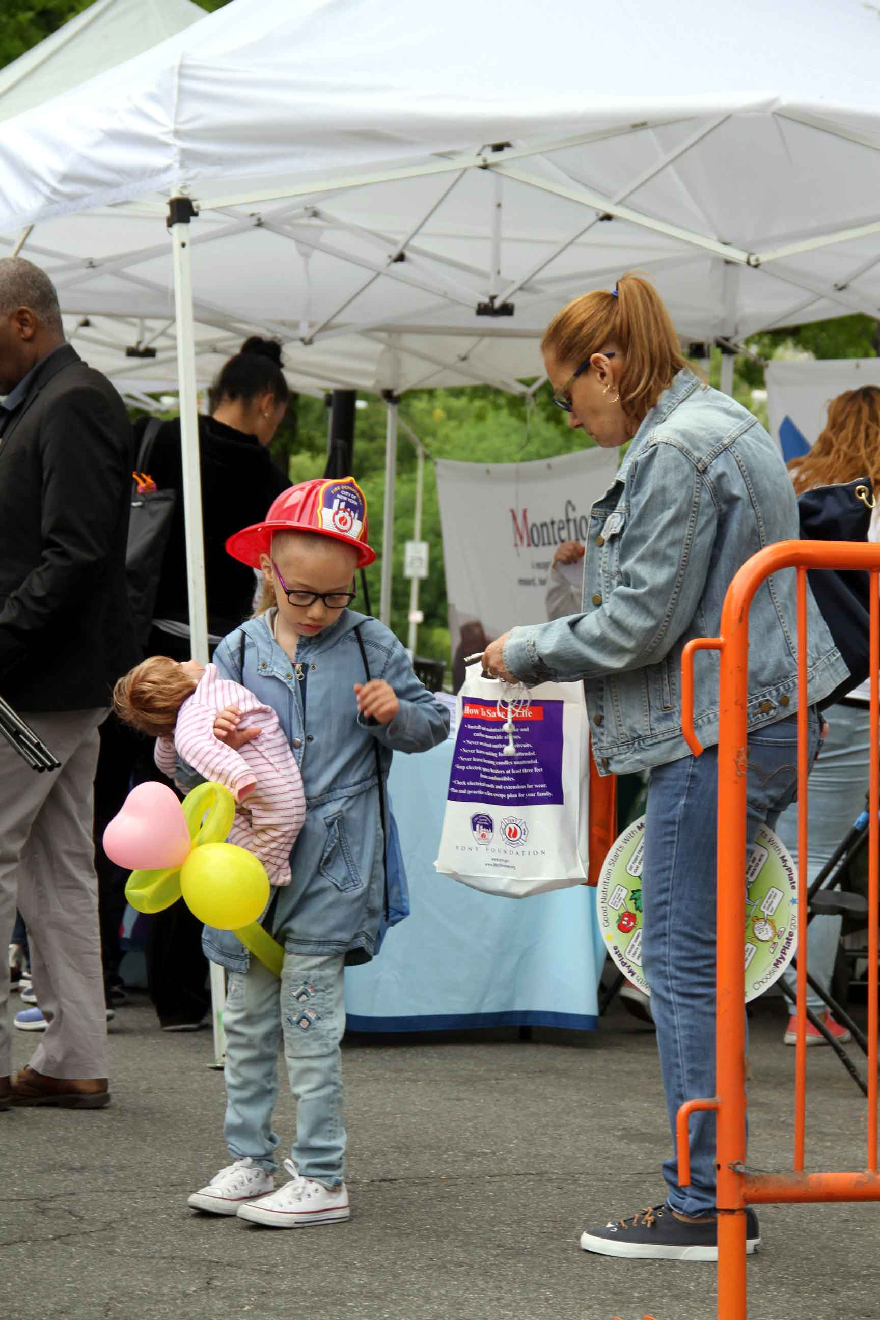 A young girl brings her stuffed animal to Montefiore's Wakefield Campus on May 9.--Photo by David Greene