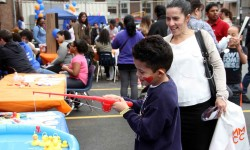 Children of all ages enjoy a host of activities during the first ever Spring-fest.--Photo by David Greene