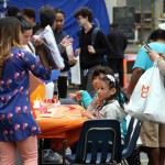Youngsters enjoy free face painting during the open house at the Mosholu Montefiore Community Center.--Photo by David Greene