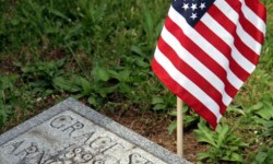 """More than 7,000 graves were """"flagged"""" by volunteers at Woodlawn Cemetery. Photo by David Greene"""