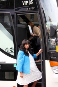 CB 7 Chair Adaline Walker-Santiago boards the bus during an annual tour of the community. Photo by David Greene