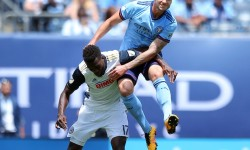 Jun 3, 2017; New York, NY, USA; New York City FC defender Maxine Chanot (4) and Philadelphia Union forward C.J. Sapong (17) fight for a header during the first half at Yankee Stadium. Mandatory Credit: Brad Penner-USA TODAY Sports