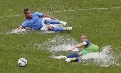 Jun 17, 2017; Seattle Sounders midfielder Osvaldo Alonso (6) and New York City FC midfielder Yangel Herrera (30) slide across the field going after the ball during the second half at Yankee Stadium. Credit: Adam Hunger-USA TODAY Sports