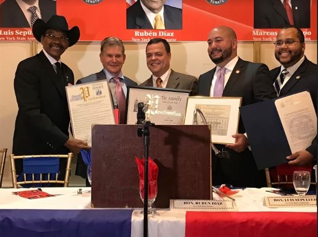 Senator Ruben Diaz joins Assemblyman Luis Sepulveda, City Councilman Rafael Salamanca and Assemblyman Victor Pichardo in honoring one of the evening's honorees, Mike LaVallie, owner of GVC school bus company, a major employer of  borough women. Photo credit: Bob Kappstatter