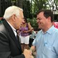 Father Louis R. Gigante greets Assemblyman Luis Sepulveda
