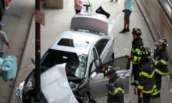 The driver jumped two lanes of traffic before jumping the curb and striking a pole on Jerome Avenue.--Photo by David Greene