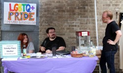 Members of the Epiphany Lutheran Church hold an open house along Decatur Avenue in honor of Gay Pride Week. Photo by David Greene