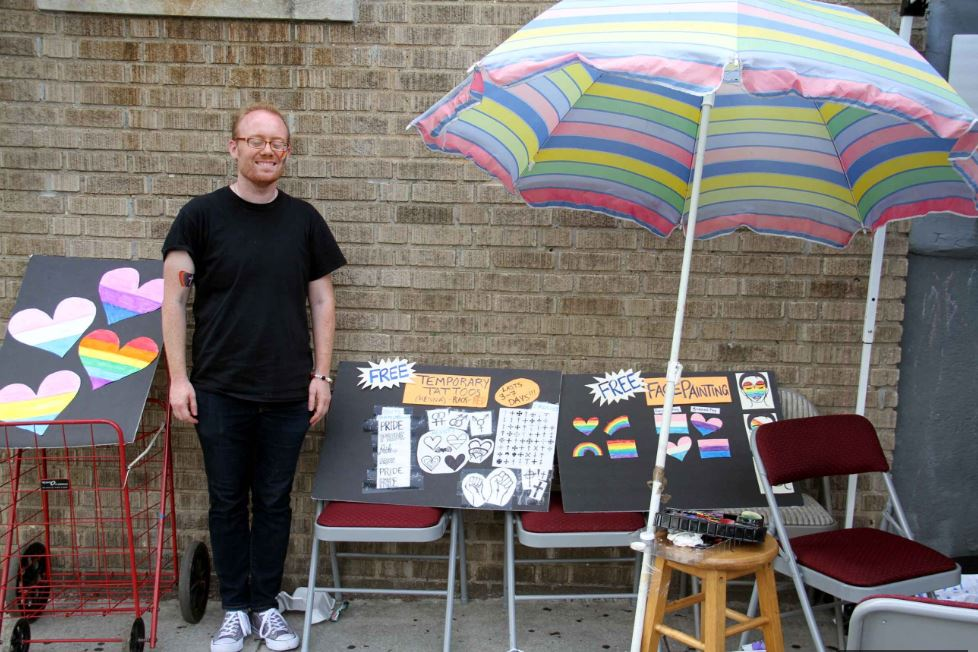 Church member Aaron offered the public free face painting and temporary tattoos. Photo by David Greene