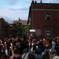 The large crowd holds candles outside of the 46th Precinct.--Photo by David Greene