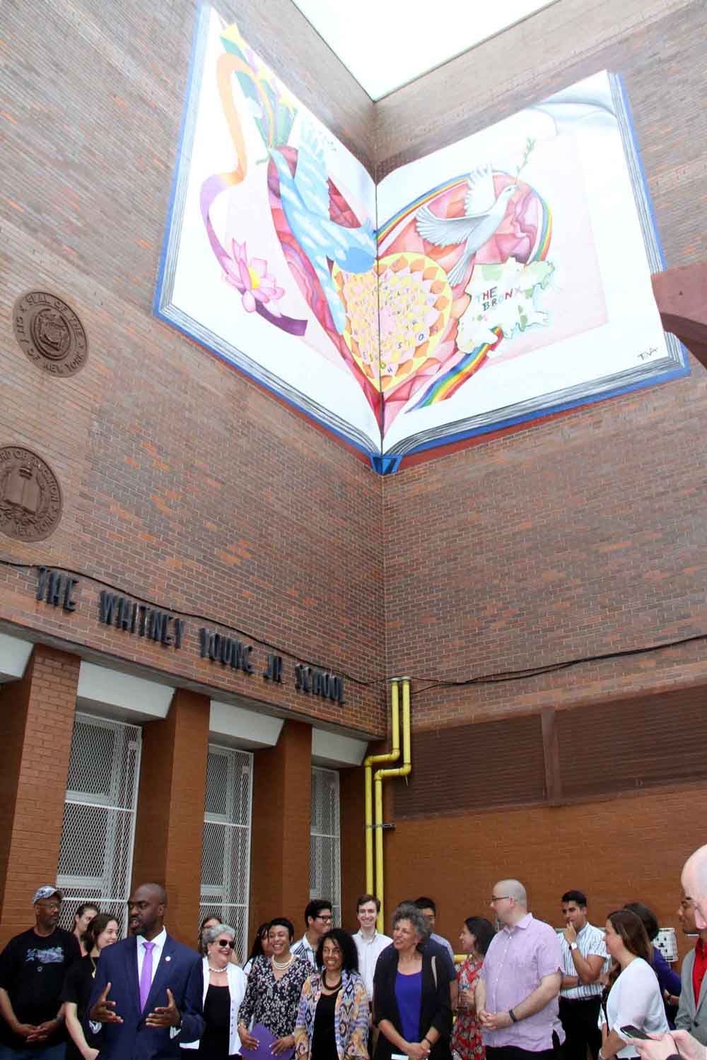 Officials unveil the new murals outside of C.S. 211.--Photo by David Greene