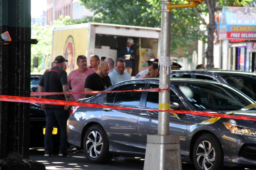 Detectives investigate the wounding of an NYPD police officer accidentally shot along Westchester Avenue. Photo by David Greene