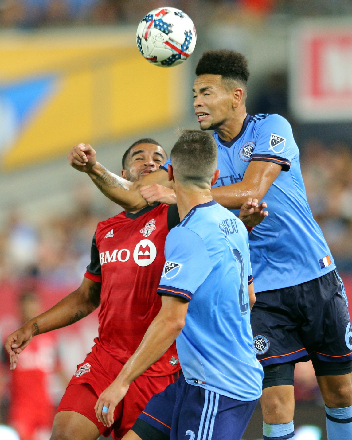 ul 19, 2017; New York, NY, USA; New York City FC defender Alexander Callens (6) heads the ball against Toronto FC forward Jordan Hamilton (22) during the second half at Yankee Stadium. Credit: Brad Penner-USA TODAY Sports