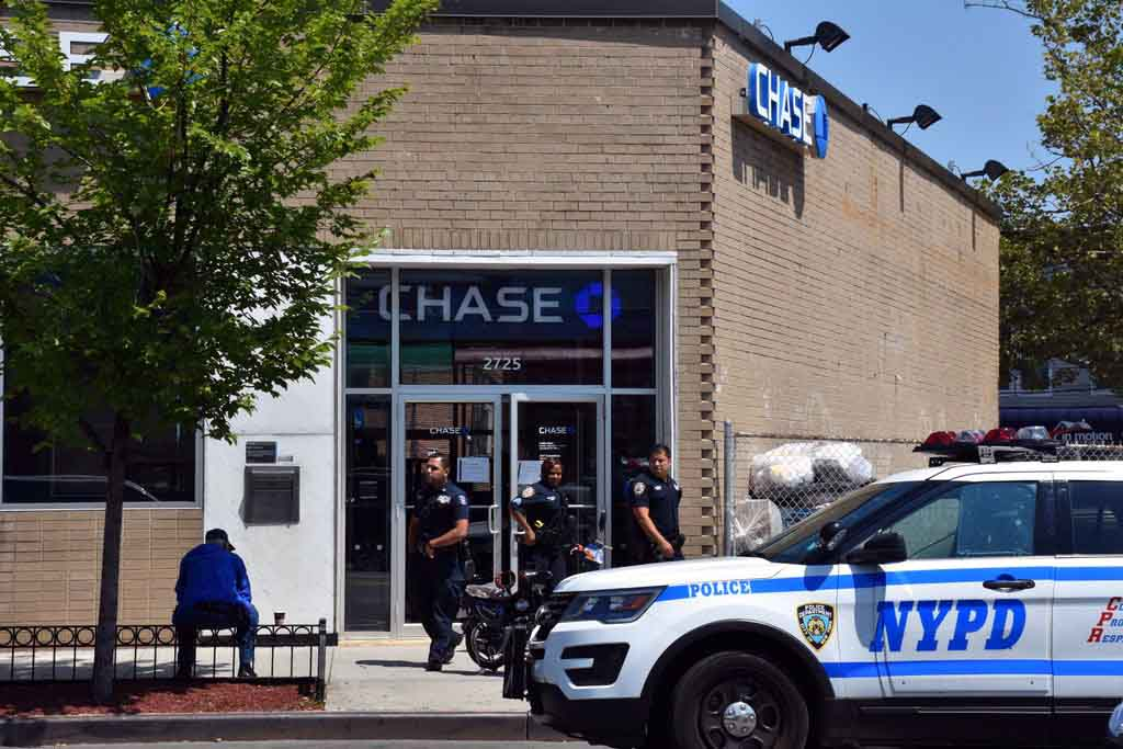 "Photos by EDWIN SOTO on Tuesday around 11:45 AM at Chase Bank 2725 East Tremont Ave.(Westchester Sq.) was Robbed of unknown amount of money taken, PD is looking for a male hispanic 6'2"" wearing a red hat, black sunglasses and black shorts, no weapon was shown."