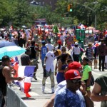 Thousands lined the Grand Concourse from East Tremont Avenue to East 166 Street.--Photo by David Greene